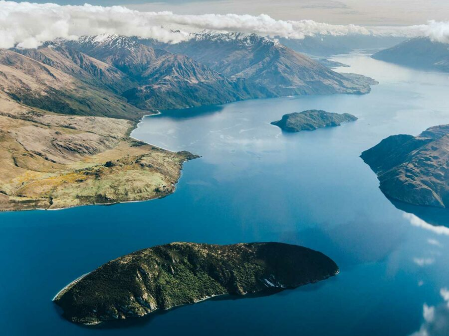 southern alps air birds eye view of lake wanaka and mountains on flight to milford sound